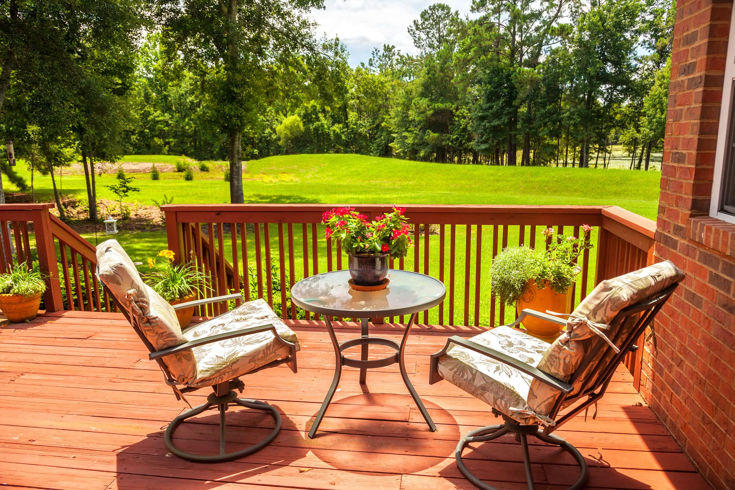 25253317 - backyard deck overlooking lake outside residential structure